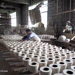 Wanqi, ouvrier à la calibreuse